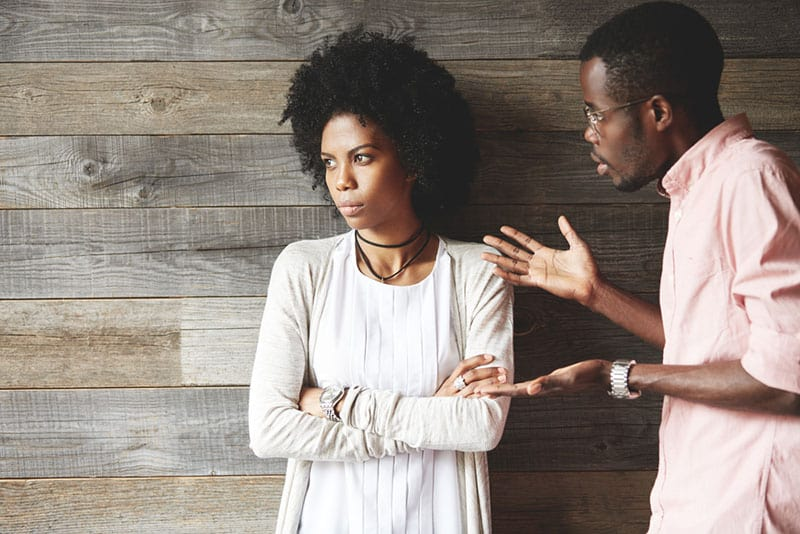 man arguing with woman while she looking away