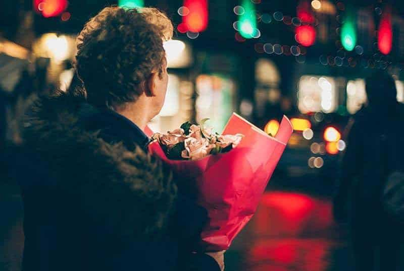 man holding a bouquet of roses