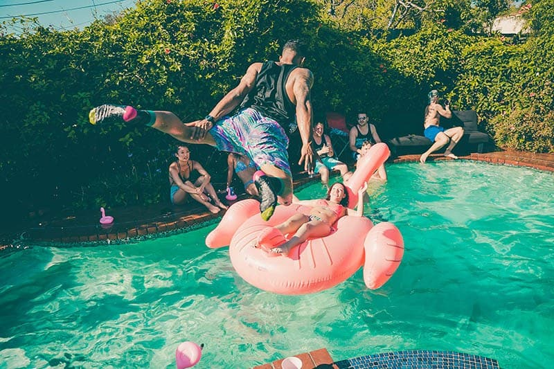 man jumping in pool