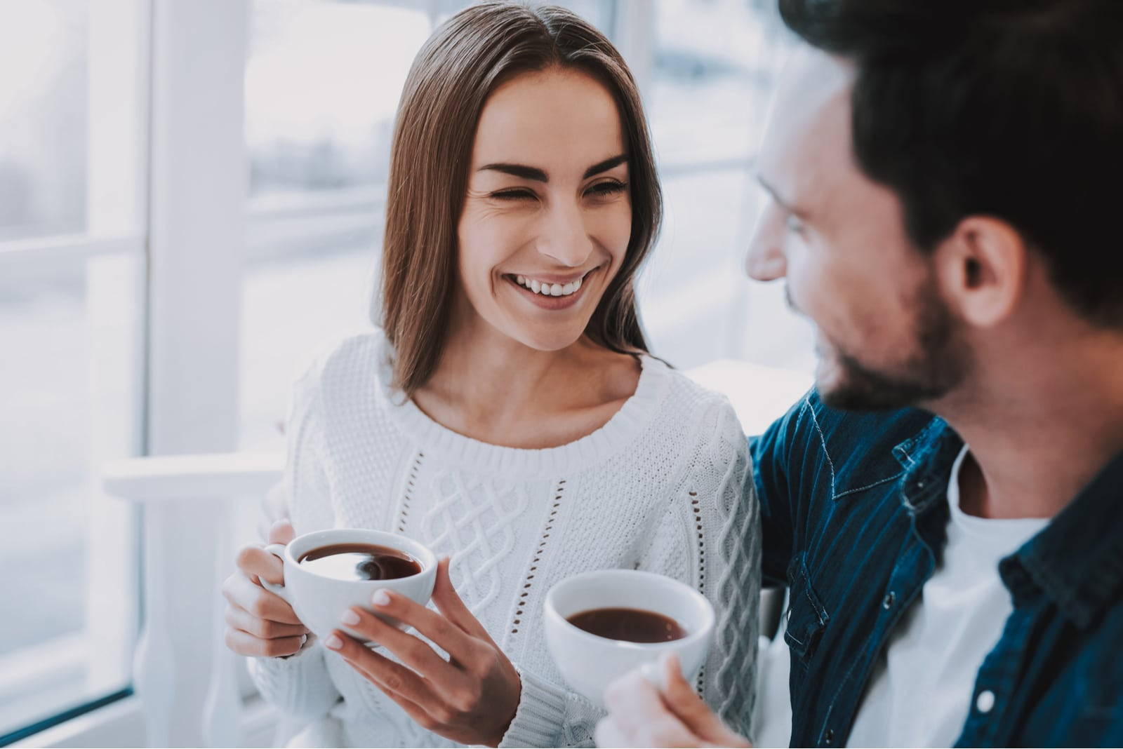 man making woman laugh