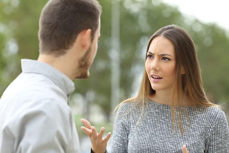 serious woman talking to man