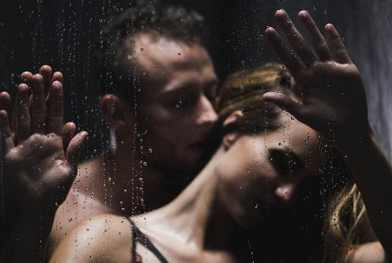 sexy man kissing a woman in the shower