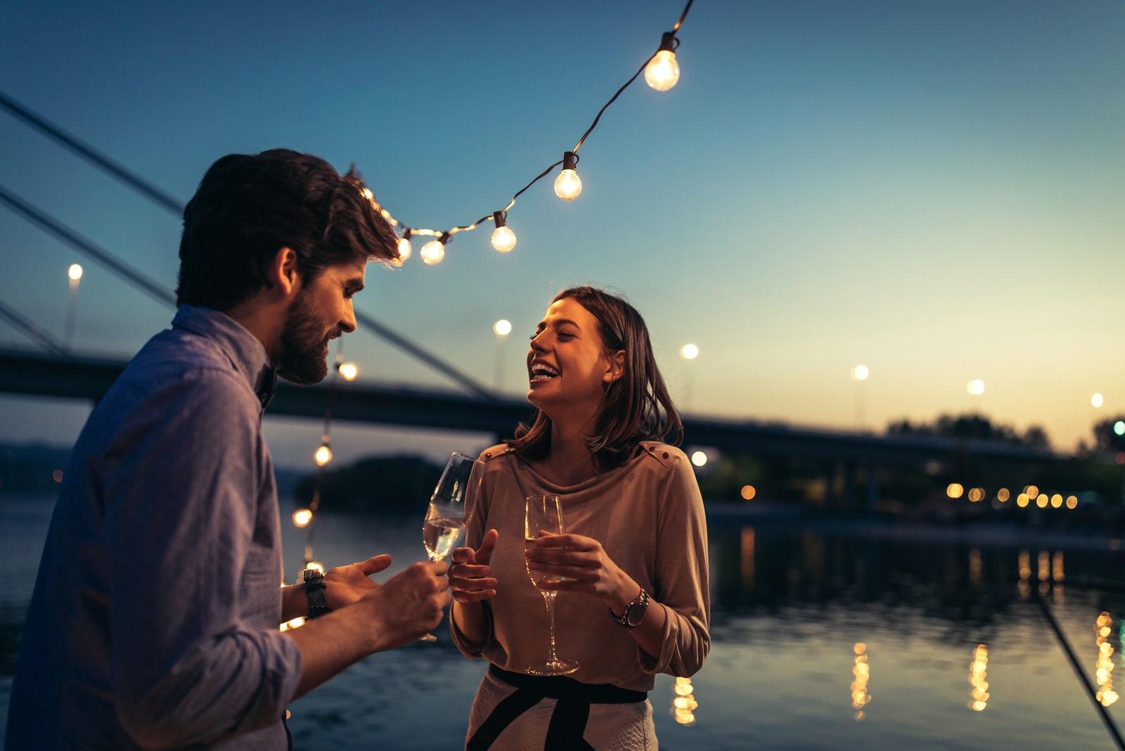 smiling man and woman talking