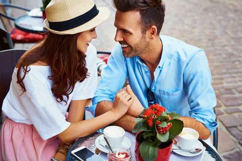 stylish couple sitting in cafe