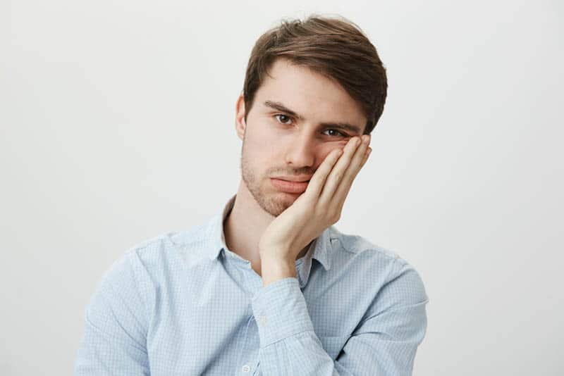 thoughtful man with blue shirt
