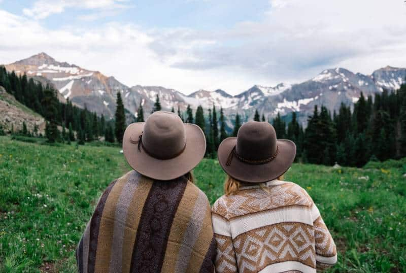 two people looking at mountain