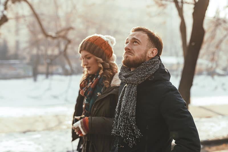 unhappy couple walking in the park