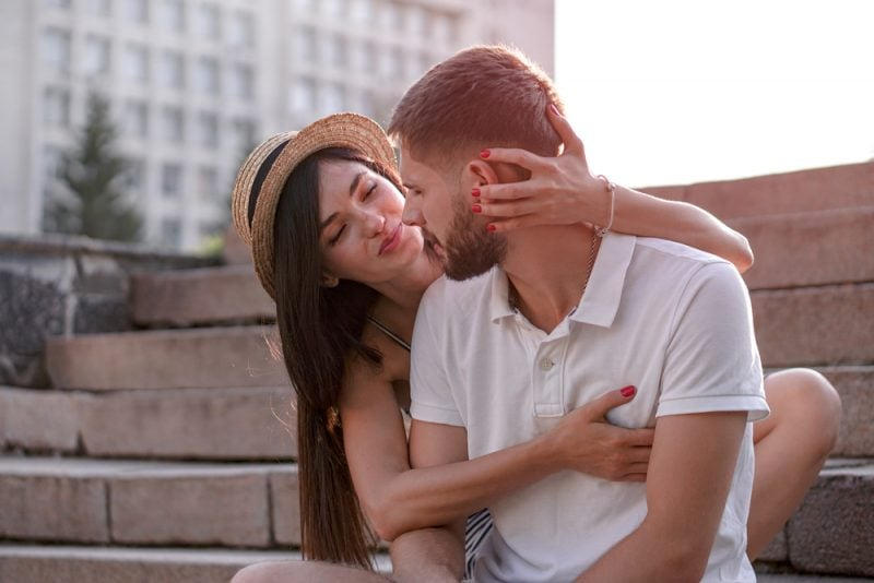 woman hugging man and smiling