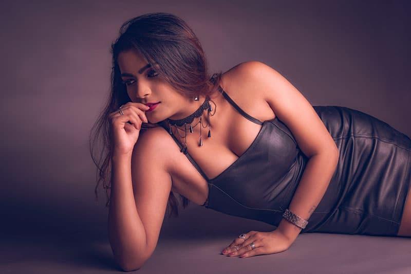 woman in black dress posing