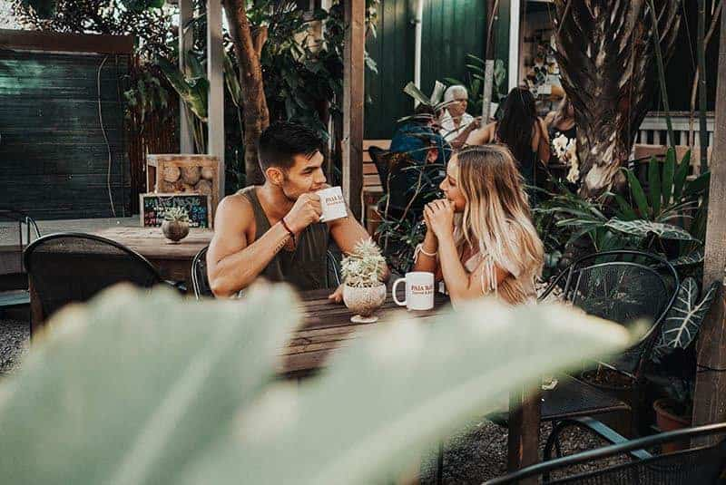 young beautiful couple talking in cafe