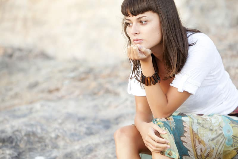 young woman in deep thoughts