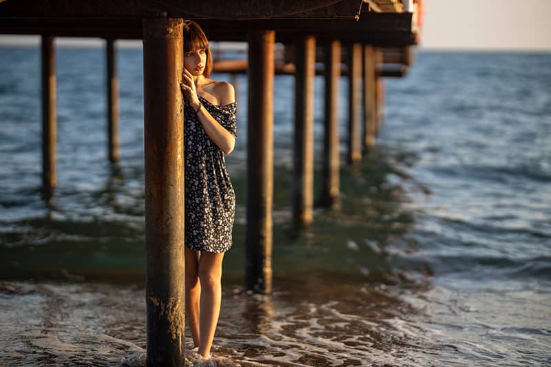 young woman standing in the sea