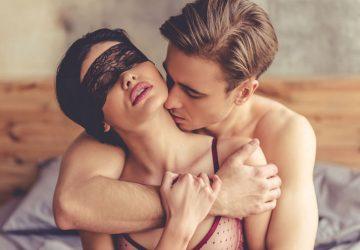 man kising a womans neck