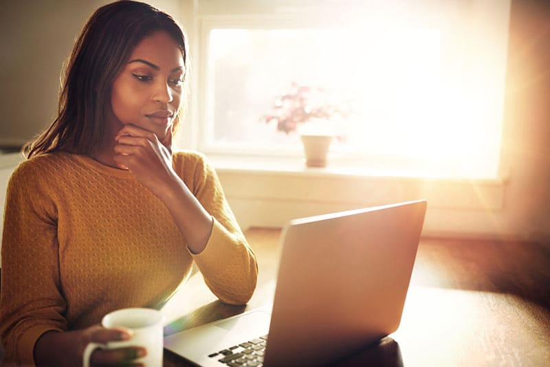 beautiful woman looking at laptop