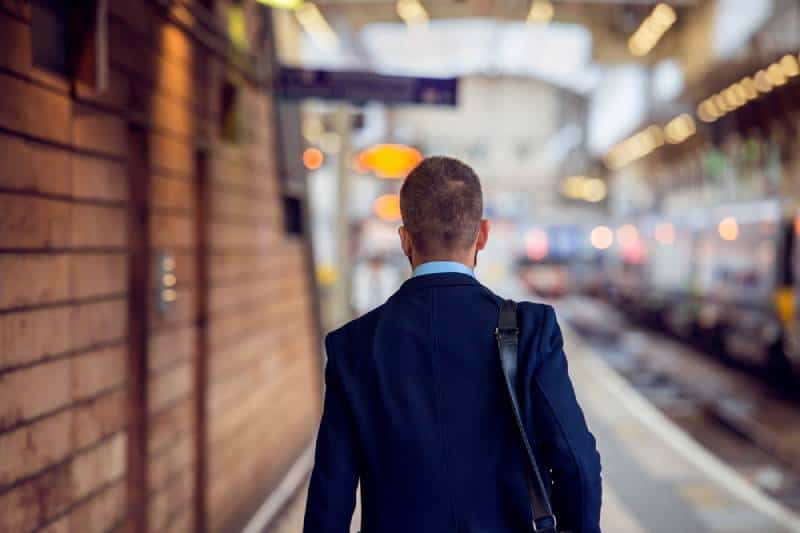 business man in suit walking at the station