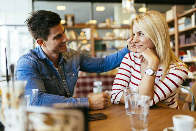 couple flirting in cafe