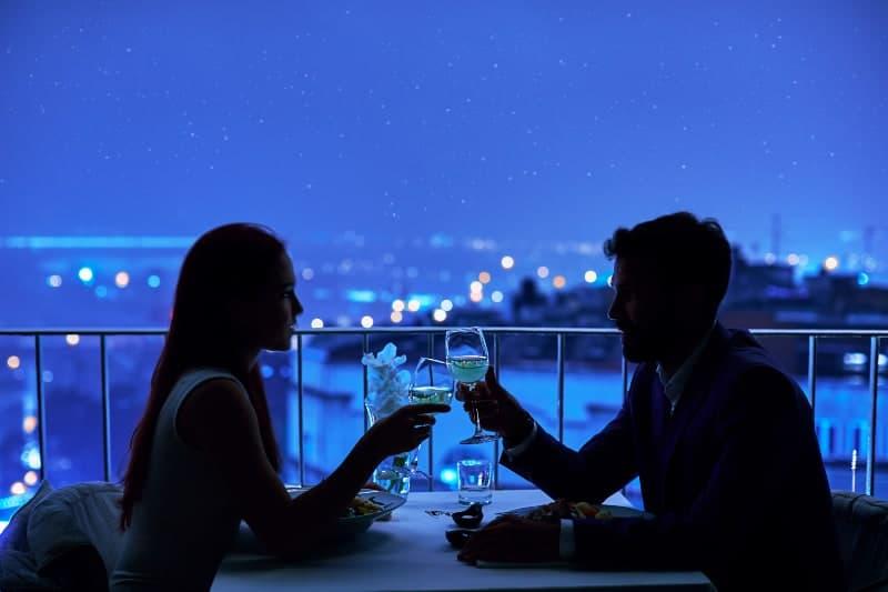 couple having dinner in the dark