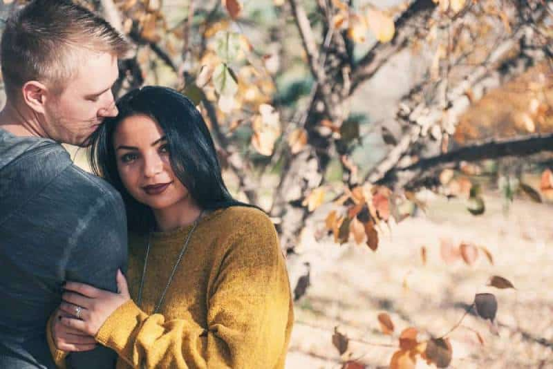 couple together with autumn color background
