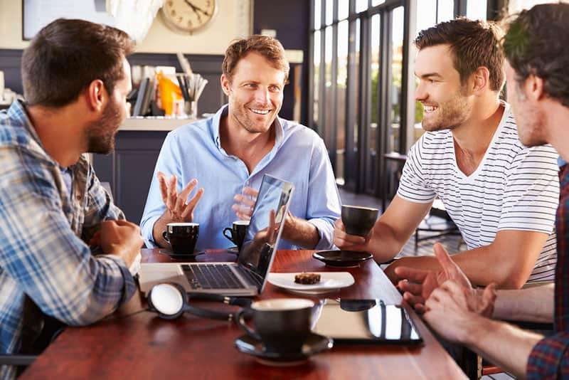 group of men talking and having coffee break
