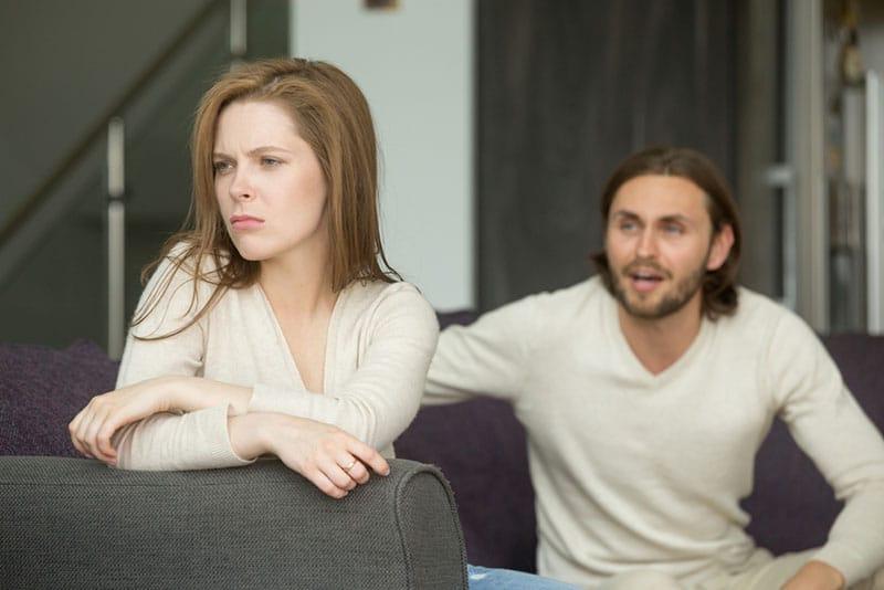 man arguing with sad woman