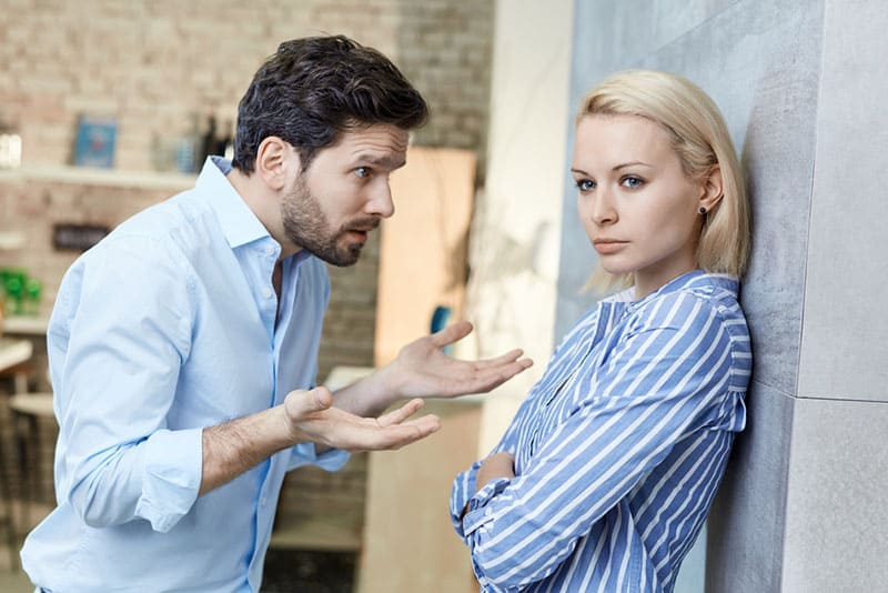 man arguing with woman