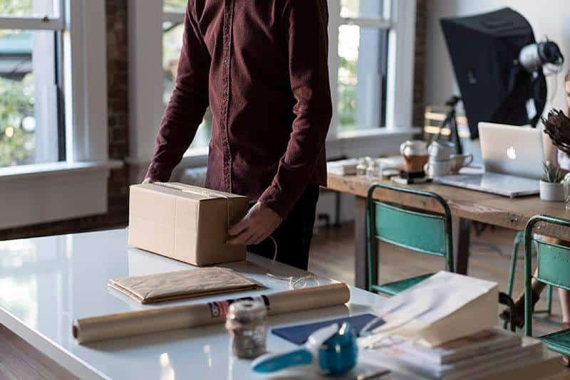 man holding packing carton boxes