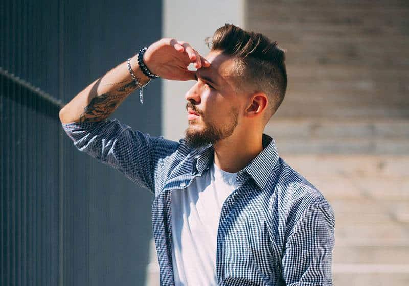 man wearing blue shirt looking away