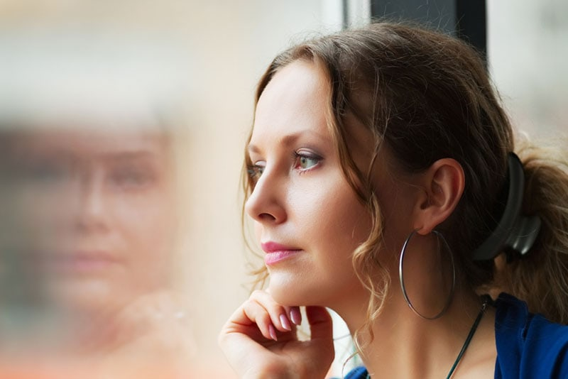 mindful woman staring at distance