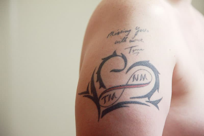 quote tattoo on mans arm