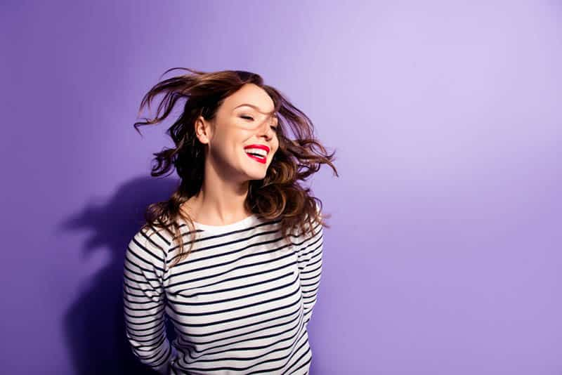 smiling woman with purple background