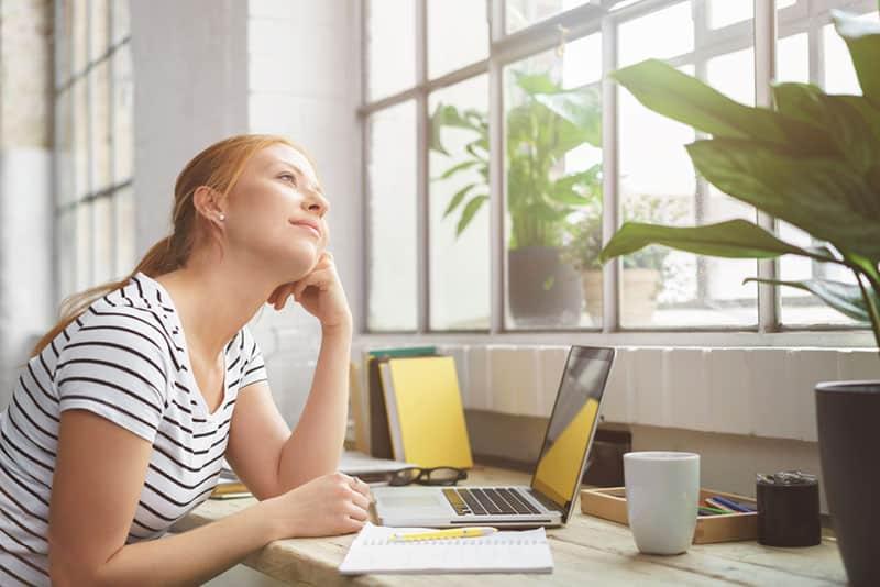 thinkful woman sitting at desk
