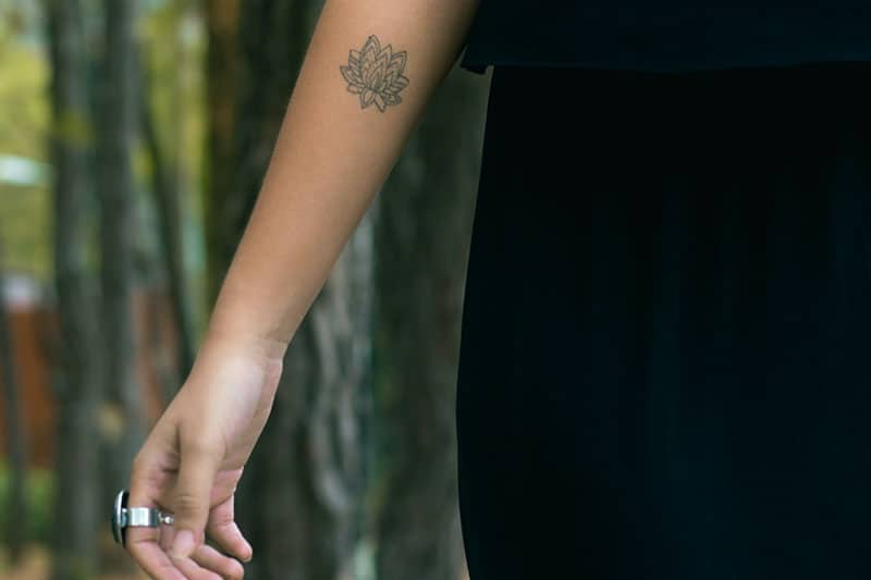 tiny flower tattoo on the hand