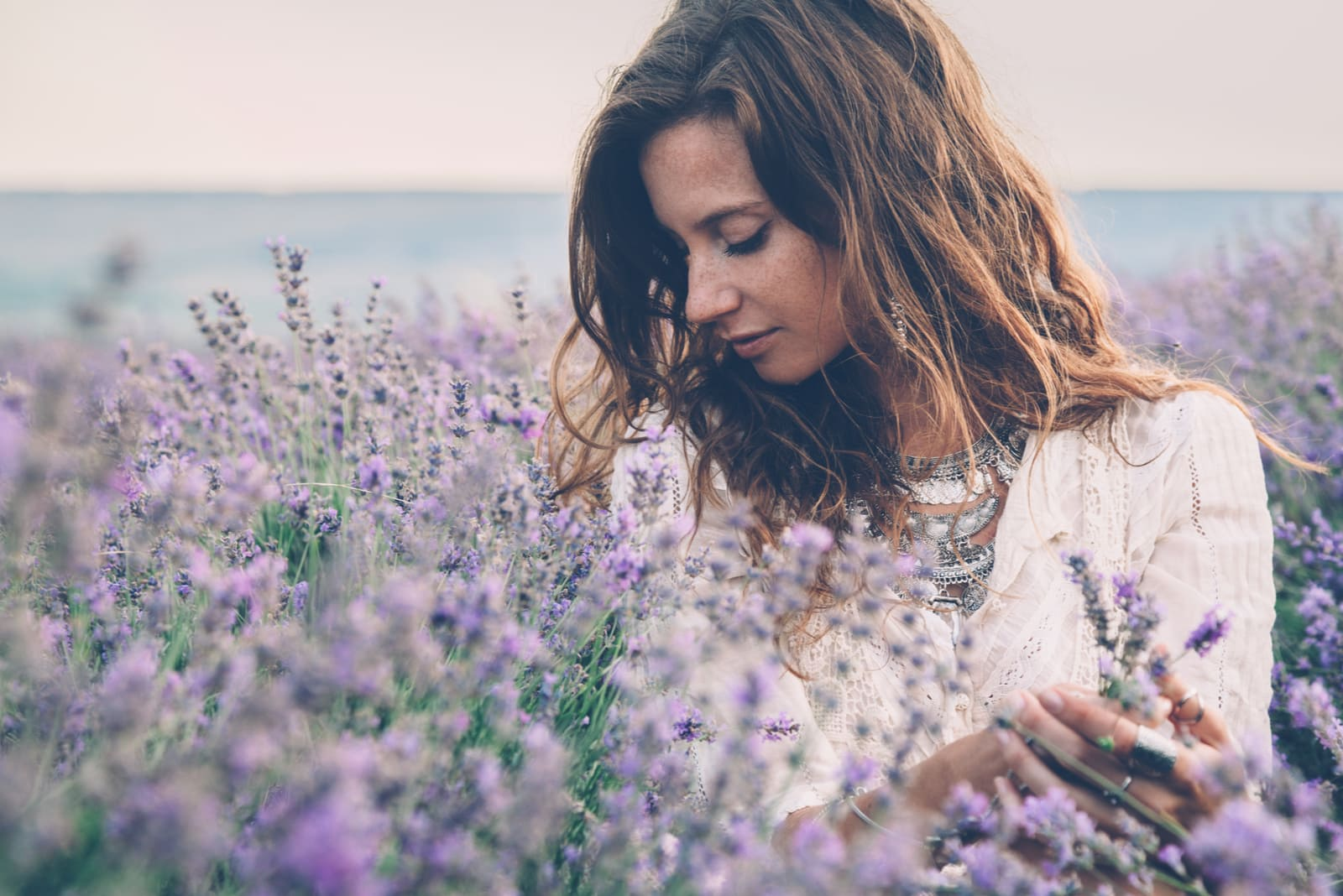 woman enjoying in the lavender field