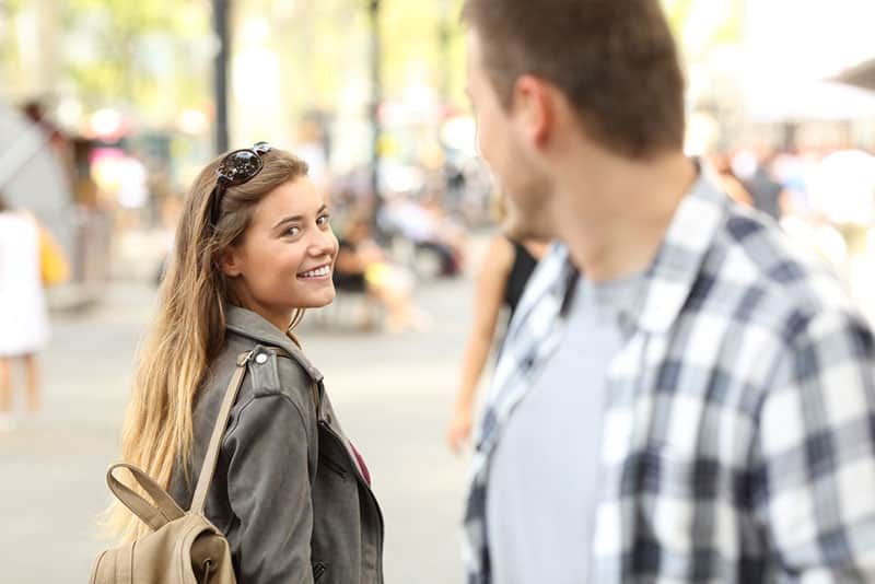 woman flirting with man on the street