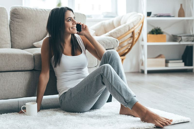 woman talking on phone in the living room
