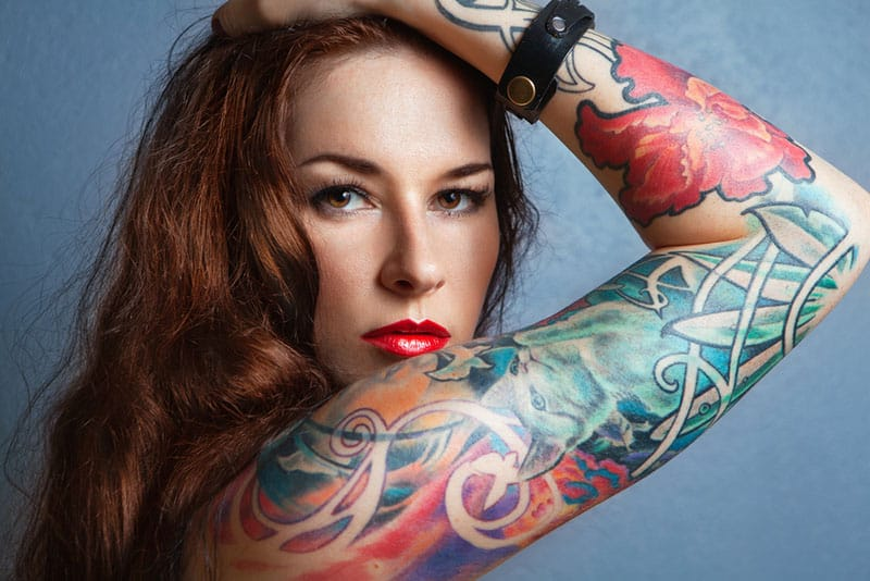 young woman posing with tattoo on arm