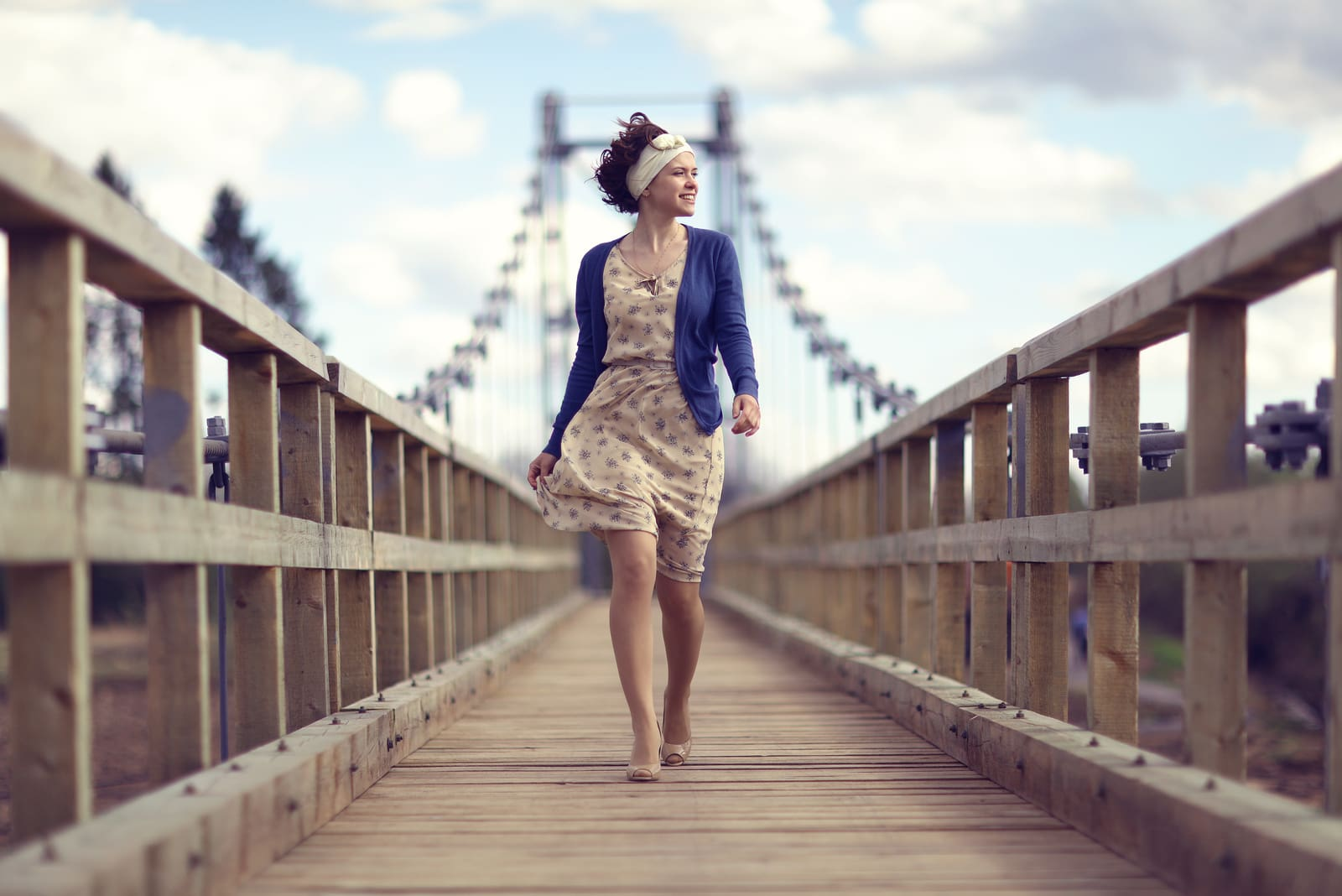 young woman walking across the bridge