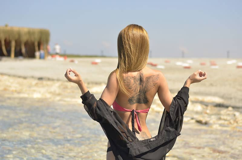 young woman with tattoo on her back
