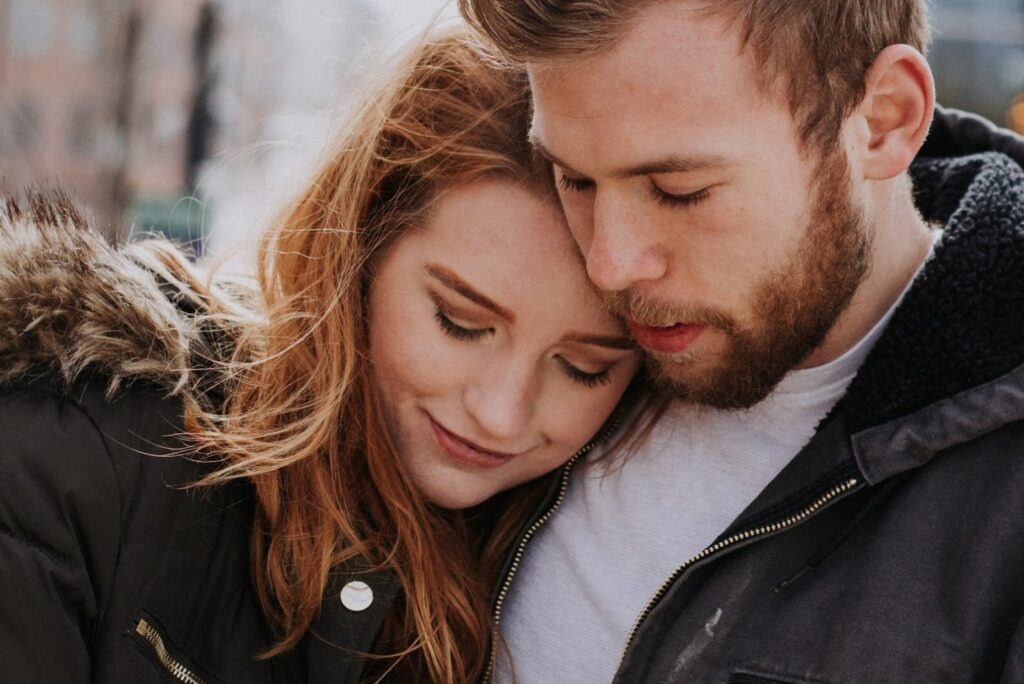 a girl leaning against her boyfriend's chest