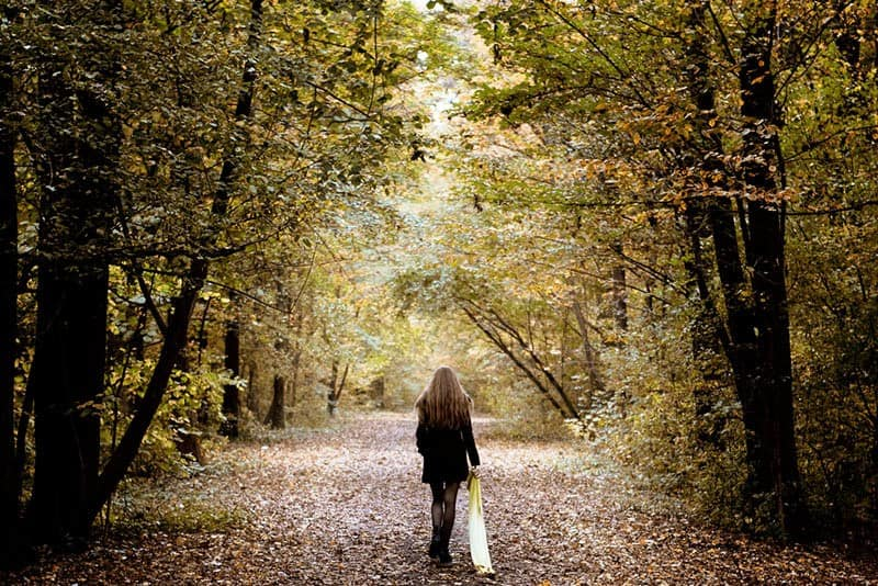 back view of woman walking in nature