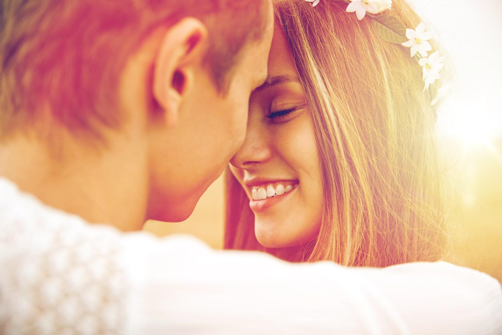 beautiful smiling woman hugging with boyfriend