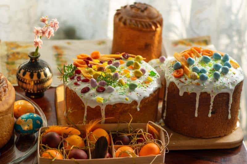 brown and white cake with orange fruits on top