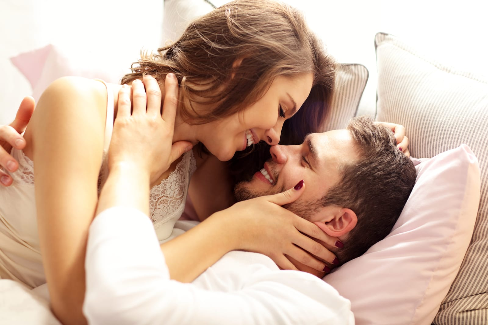charming couple cuddling in bed and talking
