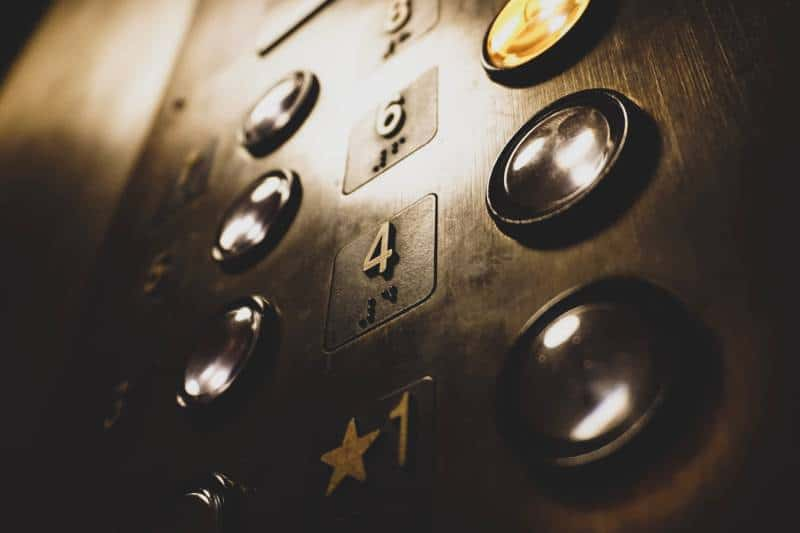close-up photo of elevator push buttons