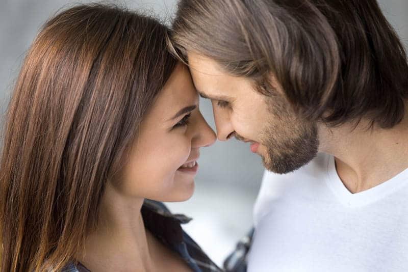 closeup photo of lovely couple eye contact