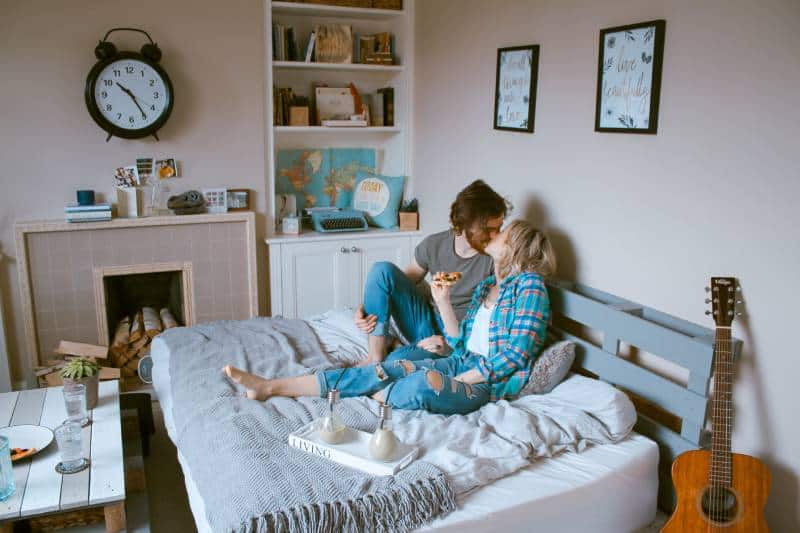couple kissing in bedroom