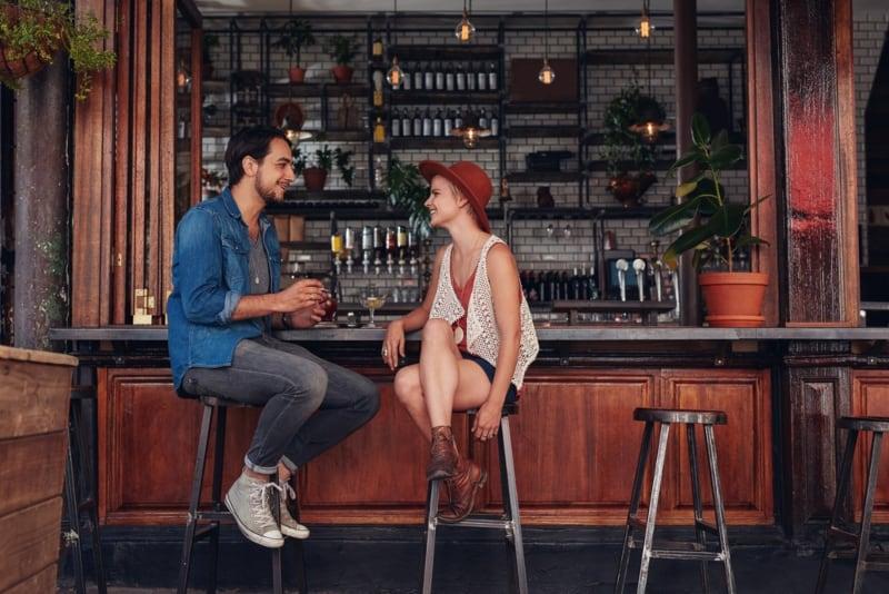 couple talking at bar