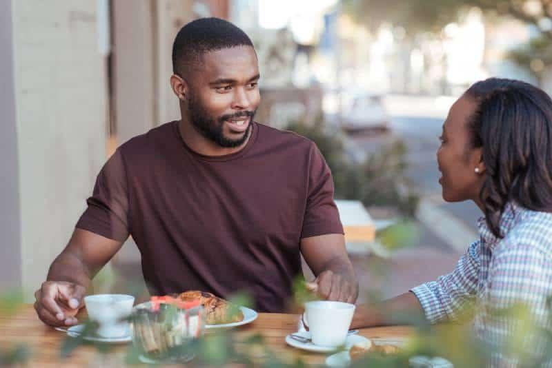 couple talking outside of cafe