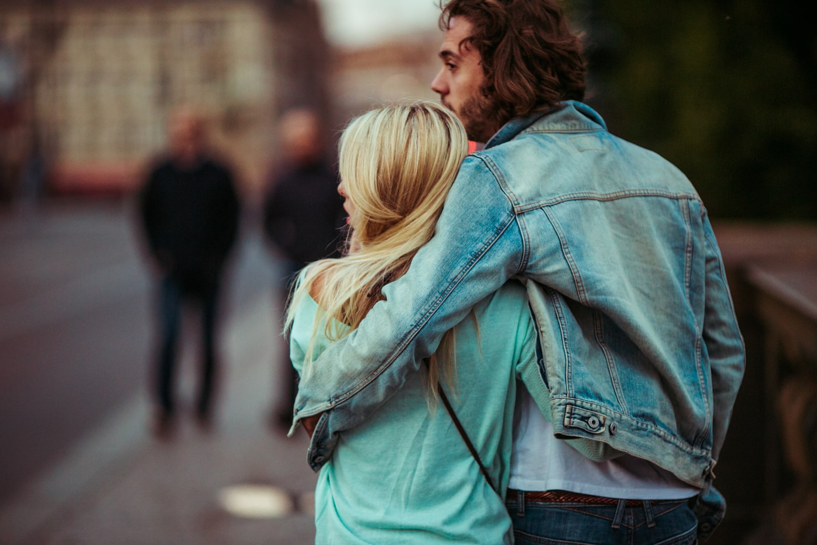 couple walking on the street hugging