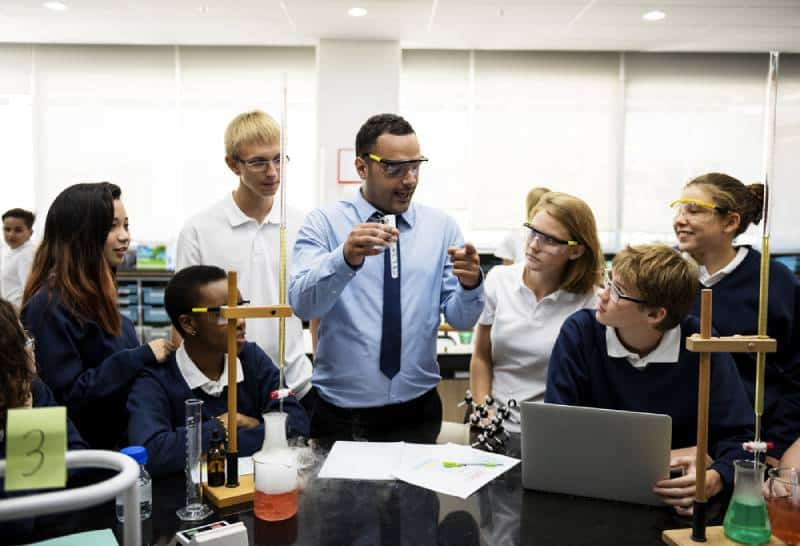 group of students science classroom with teacher